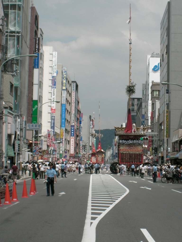 Looking down Shijo at the towering floats